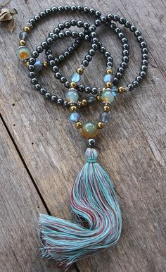 Mala made of 108, 6 mm - 0.236 inch, very beautiful hematite gemstones and decorated with hematite and color plated frosted crystal beads. The mala has a total length of approximately 83 cm - 32.68 inch.