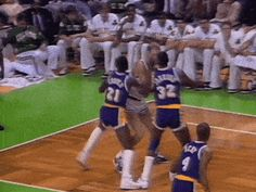 Larry Bird doubled teamed by Cooper and Magic, nothing but net.