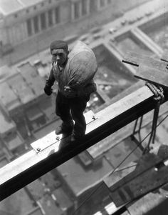 Classic construction worker. Steelworker. Photo b/w, city view, man, male, hardworking, history.