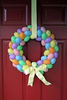 I love cheap crafts....dollar store easter wreath. Yes! mommiedawn