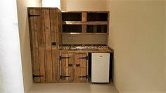 Every kitchen needs a vast cabinet that is easy to use and fulfills all the basic necessities of a household. A huge cabinet made with pallet wood, designed in a defined structure is what everyone needs. The raw color of wood makes the kitchen look user friendly. Distinct sections for various uses and doors locking items in them is an amazing invention.