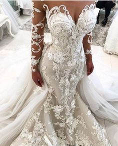 This elegant long sleeve bridal gown has ornate embroidery detail all throughout the design. Haute couture #weddingdresses like this do not have to cost a ton of money. We are in the USA and can make custom bridal #dresses that are #inspired by any design you love. Our version will look the same in style & feel but be less than the original couture design. Find out how and get pricing on any dress you love from the internet when you email #dariuscordell directly. DariusCordell.com