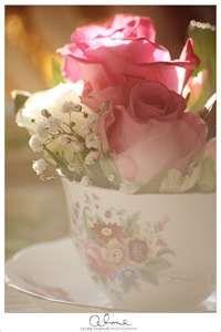 A sweet, little flower arrangement in a teacup.