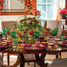 For this festive Christmas dinnertablescape, Paula took herinspiration from natural elements. Shealways checks herbackyard first for greenery and floral elements before hitting the local florist. Here she createda lush centerpiece using a mix of wintry fruits, flowers, and evergreen.  Need menu options for your Christmas dinner? Try these.