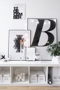 Amazing white vignette on Ikea 'Expedit/Lack' shelf