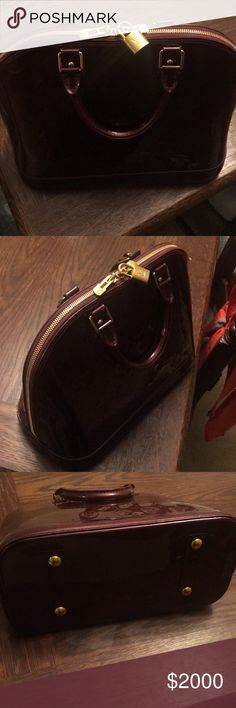 Authentic Louis Vuitton purse Burgundy/Maroon color. Only carried once has the authenticity papers with it as well as the dust rag and box it came in. Bought for $2,500 last year Bags