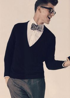Male wear: white shirt, V neck sweater, black & white plaid bow tie