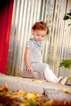 Adorable little girl in grey