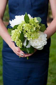 navy bridesmaid dress and green flowers