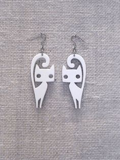 Cute cat earrings  laser cut plexiglass  Various by muchoshop, $10.00