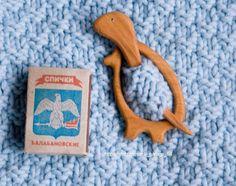 barrette, brooch, fibula Dinosaur. Wood: Juniper