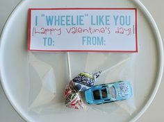 "The valentine we gave out to C's classmates last year.  I just attached the car to a piece of cardstock that had ""I 'wheelie' like having you as a friend."" printed on it.   Worked well!"