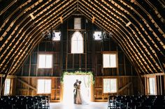 Simple greenery above the doorway adds so much! Get inspired by photos of Minnesota's most gorgeous wedding barn and event venue! #bloomlakebarn #barnwedding #rusticwedding #countrywedding #weddinginspo #weddinginspiration