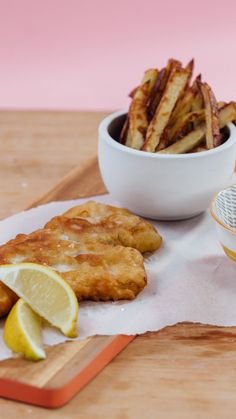Recipe with video instructions: The beloved English comfort food gets a tasty, German twist. Ingredients: Chips:, 2 potatoes, Olive oil, Salt & pepper, to taste, Batter:, 1 cup all-purpose flour, 2 tsp baking powder, 1 cup German beer, 2 cod fillets, Salt & pepper, to taste, Extra flour, Sunflower oil