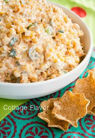 •3 (11-ounce) cans Mexican-style corn, drained   •1 (7-ounce) can chopped green chilies, drained  •1 cup (8-ounces) light or regular sour cream  •3/4 cup light or regular mayonnaise  •2 to 3 cups (8 to 12 ounces) shredded sharp cheddar cheese   •1/2 Tablespoon lime juice, optional  •1 to 2 teaspoons garlic powder  •1 teaspoon cumin  •1/4 teaspoon black pepper