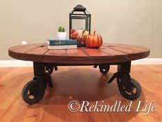 "Handmade Coffee Table Large 55"" round x 18"" high coffee table.  This spool top is stained in a dark walnut stain and sits on top of 8""  casters- giving it an industrial feel"