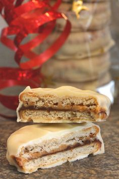 Chocolate Covered Ritz Crackers with Peanut Butter and Nutella... could do all sorts of combinations! Like girl scout tagalongs!
