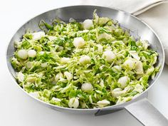 Even the pickiest eaters won't shy away from this Brussels Sprout Hash, sweetened with honey and complemented by sauteed pearl onions.