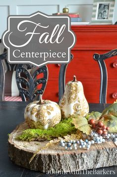 Fall Centerpiece - all you need is an old log to saw -  2 cute decoupaged pumpkins and you have instant Dining Room Table Decor