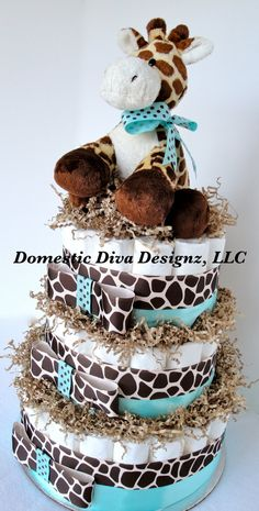 This super cute giraffe themed baby diaper cake is securely placed on a white cake platter and is made with approximately 61 size 1 Pampers