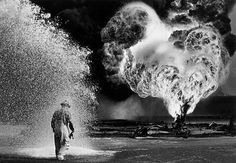 Chemical sprays protect this fire fighter. Greater Burhan, Kuwait . 1991