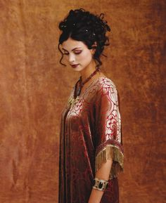 Inara (Morena Baccarin) from Firefly.  Costume designers Jill Ohanneson and Shawna Trpcic.  Now, Inara was one of my least favorite characters, but **damn** did she have a nice wardrobe.