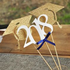 Confetti Momma's Graduation Centerpiece is so sophisticated and chic! Use these graduation cap and 2018 wands alone in a vase or pair them with a bouquet of flowers. Either way, they will make a great focal point at your graduation party. The caps are made using premium glitter gold cardstock, the 2018 was made using d