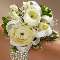 The FTD® White Wedding Corsage. Wrist bouquets with bling and dazzle are easy to customize. For Weddings by PJ, consider Mexico, Caribbean, Hawaii, Central America, Port-of-Call weddings - your destination, wedding and travel specialist. www.destinationweddings.travel