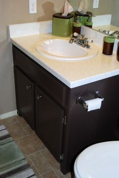 Painted bathroom cabinets - dark color to contrast our light counter tops and floor