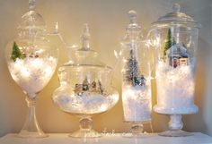 #DIY White Christmas Décor: Cute idea to use the apothecary jars for snow globes.