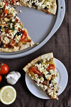 Greek Pizza. May Fav!  1/2 lb of creamy feta  1 head of garlic, cloves removed and peeled  1 tablespoon olive oil  1/4 cup fresh dill  3/4 cup freshly grated mozzarella cheese  1 15-ounce can of artichoke hearts, chopped  1/2 cup chopped kalamata olives  1/2 red onion, sliced  3-4 campari tomatoes, cut into wedges  1 roasted red pepper, cut into slices  Grilled Chicken