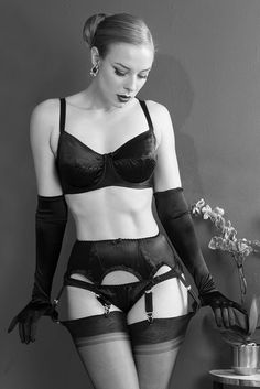 Who can resist sleek the sleek black straps of our delicious Bizarre Lingerie? This sexy little suspender belt and knicker set is our new favourite for wild nights in, in soft black satin for the slinkiest of fits. Team with our circle-stitched Bizarre Bra for a little vintage point - you asked for an underwired vintage-style range, we provided. Modeled by Sam Elson.