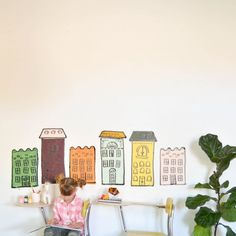 Fun and easy kid friendly (like they actually can help!) wall decor inspired by Madeline! All you need is left over paint and black vinyl!