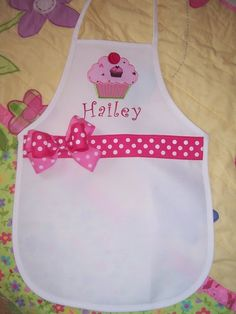 Maybe not this one, but a cupcake apron with her name on it for the cupcake decorating party
