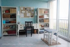 Desk in between two book cases, cork board above. Cute!
