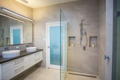 Stone wall tiles and clean lines make for a restful and modern contemporary ensuite bathroom.