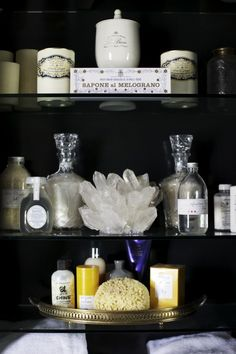Styling ideas for bathroom shelves . Great use do adding storage space and making it look great too.