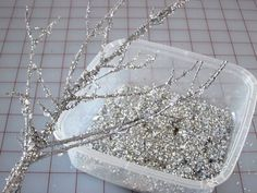 Branches. Silver paint. Spray adhesive. Glitter. Cheaper than buying them at the craft store