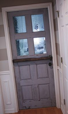 Always wanted a dutch door, but don't have the extra cash? You can easily redesign your existing door into a functional, and stylish dutch door.  The owner of this DIY tutorial chose to keep the vintage look of the original door, but really, you could use any style of wood door for this project.  DIY home. dutch door. interior design.