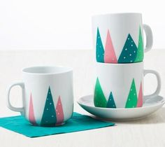 These mugs are perfect for sipping cocoa by the fire or as last-minute crafty gifts! See More: Cheery Holiday Cards and Gift Tags Materials: Stencil tape Mugs Basic brush set Martha Stewart Crafts Multi-Surface Craft Paint in Spearmint Green, Mermaid Teal, Camellia Pink, and Sterling … 1. Gather materials