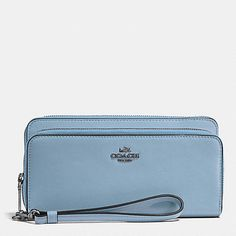 Crafted in rich glove-tanned leather and accented with our iconic horse-and-carriage logo, this double-zip design has a full complement of card pockets inside and a separate pocket for a phone. Finished with a slender leather wrist strap, it can be carried as a small clutch.