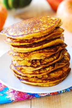 Hearty pumpkin pancakes for Thanksgiving: moist, light, and fluffy! Full of pumpkin flavor and with just the right amount of spice! | JuliasAlbum.com | breakfast pumpkin recipes