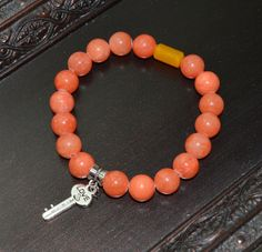 "Coral and Yellow ""Key to Love"" Beaded Stretch Bracelet"