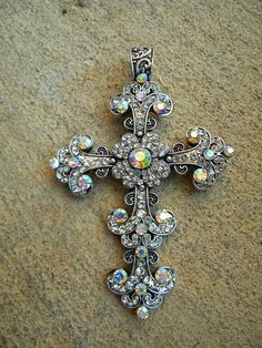 I ADORE this Silver cross pendant I have a similar one, I have like 20 cross pendants :)