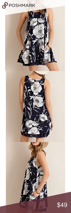 Lace Hem Floral Dress Floral tank dress with a back button closure and a lace hem. Available in navy and Ivory. This listing is for the NAVY. Brand new. Runs loose. NO TRADES DON'T ASK. Bare Anthology Dresses Mini