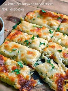 Low Carb Cauliflower Breadsticks with fresh herbs, garlic, and lots of ooey gooey cheese atop a cauliflower crust looks and tastes like cheesy bread! One of my favoite low carb recipes! Cauliflower Breadsticks, Cheesy Cauliflower, Cauliflower Crust, Breadsticks Recipe, Garlic Breadsticks, Cauliflower Cheese Bread, Califlower Garlic Bread, Cauliflower Low Carb Recipes, Appetizer Recipes