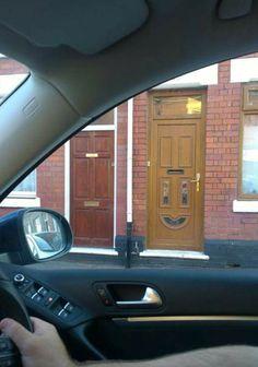 Happy Door Hung Upside Down