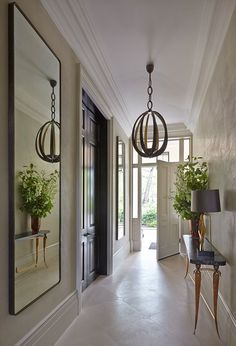 Very nice light fixture in this hallway. Well-designed and decorated home.
