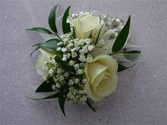 cream wrist corsage;  cream spray roses, baby's breath, ruscus