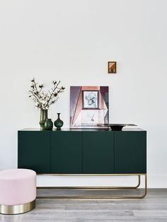 Deep green sideboard and baby pink ottoman via Huntly
